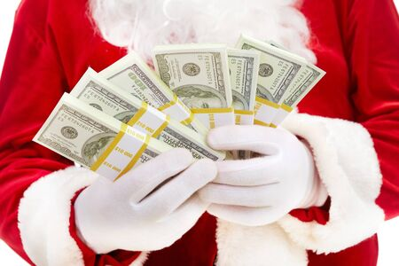 cash in hand: Close-up of Santa�s hands with stacks of dollar banknotes