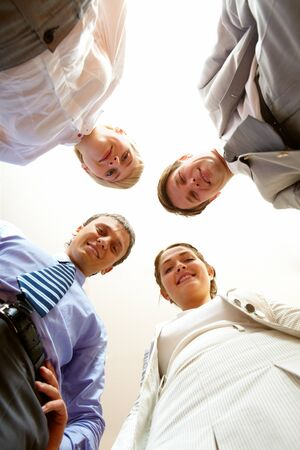 Below angle of smart business people looking at camera  Stock Photo - 7803993
