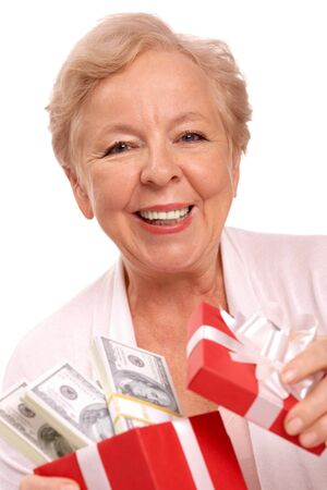 Portrait of aged female with dollar bills in giftbox looking at camera Stock Photo - 7803927