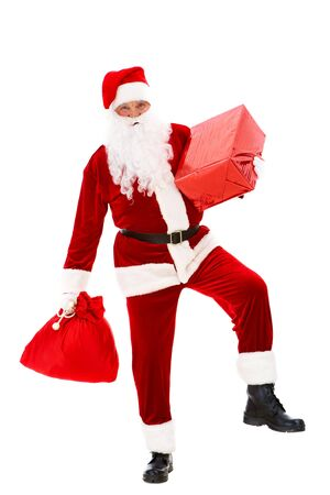Photo of happy Santa Claus with red giftbox and sack in hands photo