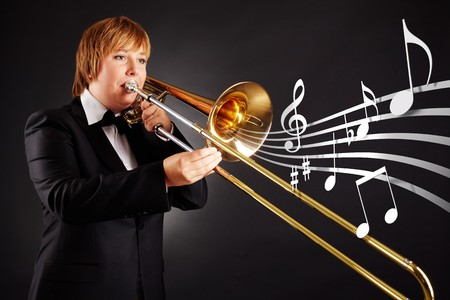 Portrait of young female playing the trombone photo