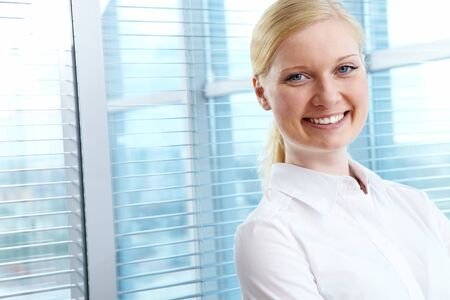 congenial: Portrait of pretty female looking at camera with smile