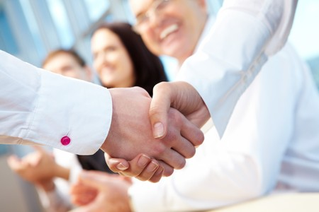 business contract: Image of business handshake after signing new contract