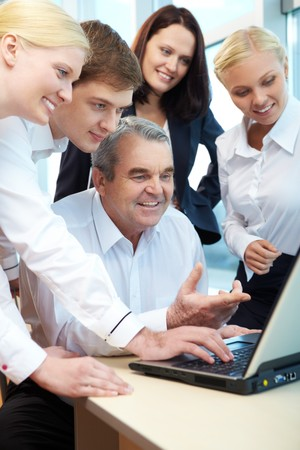 Photo of workteam planning new project in office Stock Photo - 7873743