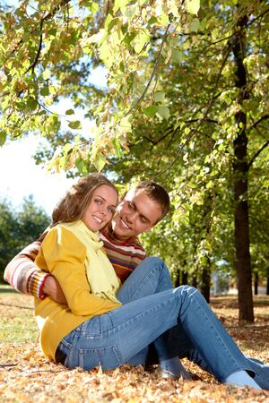 Photo of happy girl with handsome male relaxing in park photo