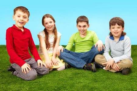 Image of happy boys and girls having rest on green grass Stock Photo - 7873781