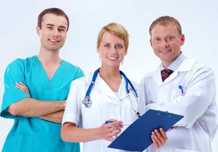 Portrait of friendly therapists standing in line and looking at camera with smiles Stock Photo - 7873738