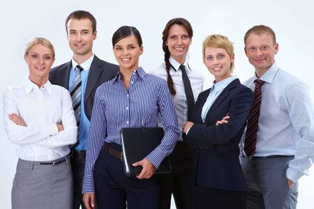 spokesperson: Portrait of friendly business team posing in front of camera