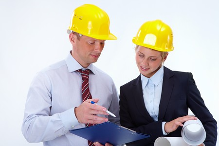 Portrait of confident worker discussing a project with his pretty colleague near by Stock Photo - 7873736