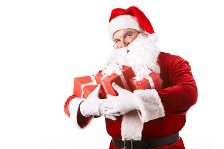 claus: Photo of happy Santa Claus with giftboxes looking at camera Stock Photo