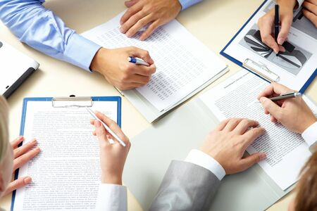 team strategy: Image of business people hands working with papers at meeting