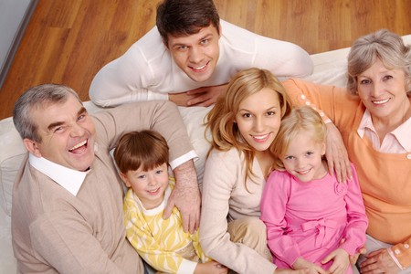 Portrait of senior and young couples and children looking at camera at home Stock Photo - 7873857
