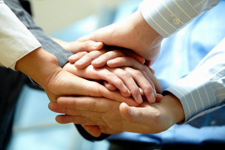 Image of business people hands on top of each other Stock Photo - 7882333