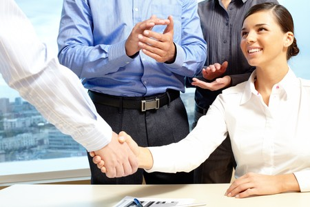 white achievement: Image of business handshake after making an agreement