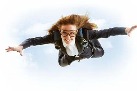 woman flying: Conceptual image of young female flying with parachute on her back