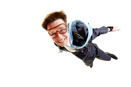 skydive: Conceptual image of young businessman flying with parachute on back Stock Photo