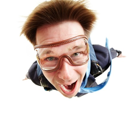 Wide angle of young businessman flying with parachute on back Stock Photo - 7873804