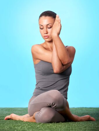 female pose: Portrait of young woman going for yoga in isolation Stock Photo