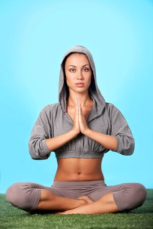 Portrait of young woman meditating in pose of lotus in isolation Stock Photo - 7873836