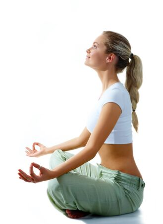Profile of woman meditating in pose of lotus in isolation photo