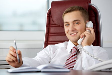 Photo of smart businessman calling somebody and smiling during communication Stock Photo - 7873885