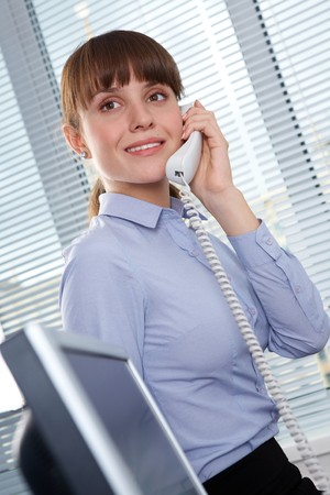 Photo of smart businesswoman calling somebody in office Stock Photo - 7873897