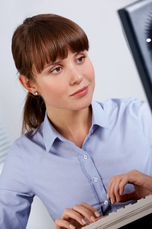 Image of young employer looking at computer monitor in office Stock Photo - 7873893