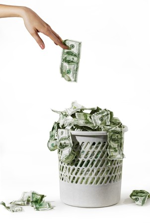 money is in a trash bucket over hand with dollar  photo