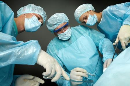 Bottom view of three surgeons operating Stock Photo - 7964933