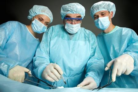 Portrait of three surgeons standing surprised Stock Photo - 7964950