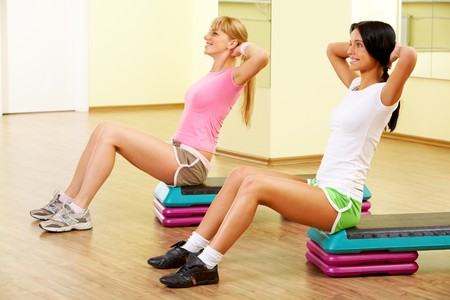 Image of two young women practicing physical exercises photo