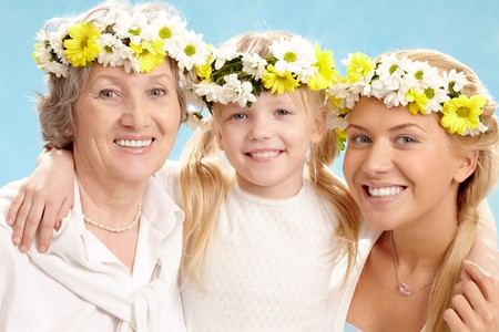 Portrait of grandmother with adult daughter and grandchild with floral diadems   Stock Photo - 7964958