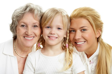 Faces of grandmother with adult daughter and grandchild in line  photo