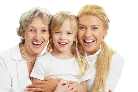 grandmother mother daughter: Portrait of grandmother with adult daughter and grandchild laughing