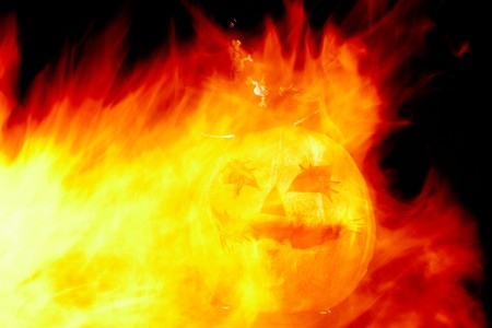 Image of Halloween pumpkin with flames of fire photo