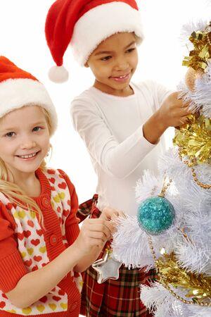 Image of smiling children decorating Christmas tree  photo