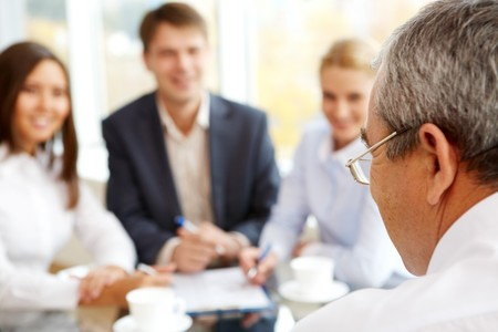 subordinate: Rear view of boss looking at subordinate persons during briefing  Stock Photo