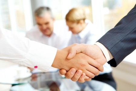 male parts: Close-up of business people making agreement in the office