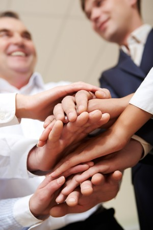 Close-up of hands on top of each other symbolizing support Stock Photo - 7965007