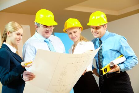 Portrait of worker group looking at new design project Stock Photo - 7965066