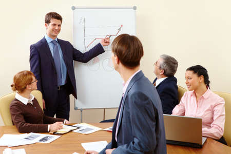 Image of businessman doing presentation to businesspeople during conference  photo