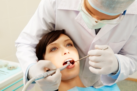 hygienist: Image of a dentist curing a girl�s teeth   Stock Photo