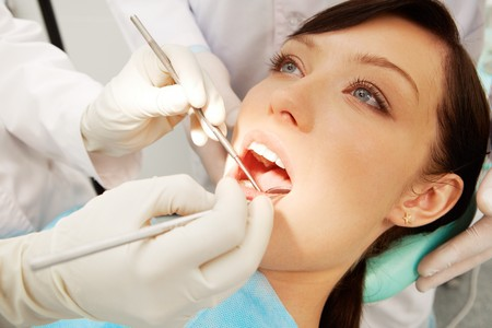 Close-up of a girl examined by two dentists Stock Photo - 7965291
