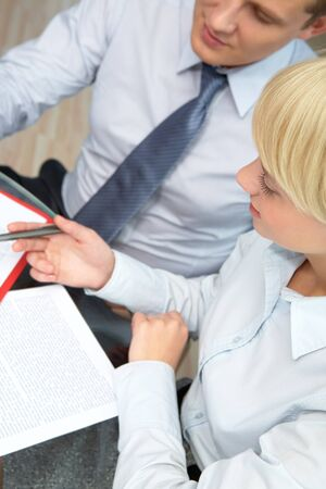 confident employees discussing papers in office Stock Photo - 7965067