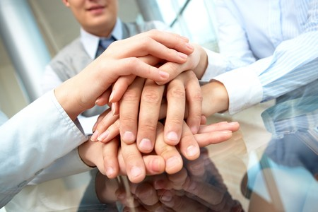 Image of business people hands on top of each other Stock Photo - 7965142