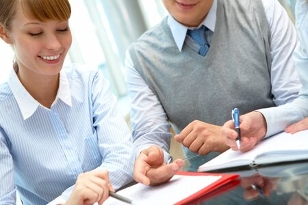 confident employees discussing ideas in office Stock Photo - 7965132