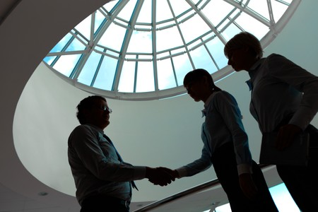consensus: Outlines of business people making agreement in the office