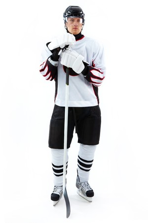 Portrait of ice-hockey player with hockey stick Stock Photo - 8015741