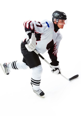 Portrait of energetic player playing hockey on ice photo