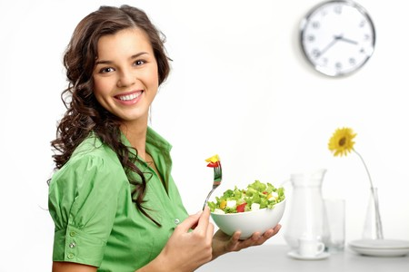 salad fork: Portrait of a girl looking positive and holding a bawl with salad